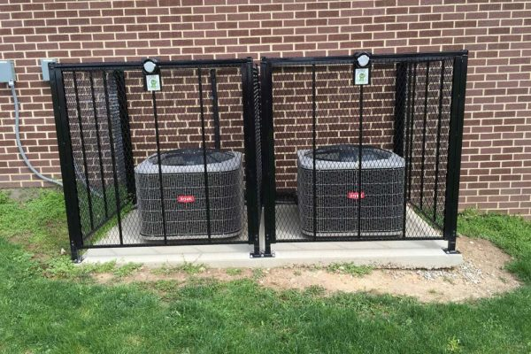 Bryant split system AC units with security cages in Springfield OH
